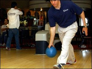 Democratic congressional candidate Ben Konop takes aim at Seneca Lanes in Fostoria. Mr. Konop, who is attempting to unseat Rep. Mike Oxley, is on a six-day, 23-city bowling tour in an attempt to drum up grass-roots support in Ohio's 4th District.