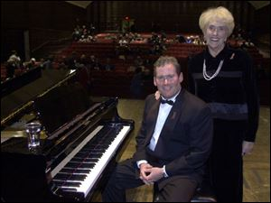Tim Shew and his mother, Susie, at the 2001 benefit at UT.
