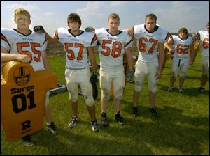 Otsego's offensive line includes all returning starters - from left, Adam Thomas, Cale Swanson, Nick Horen, Caleb Clark, Todd Wilson and Ryan Moser.
