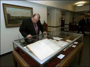 READING THE LAW: Judge Bill Skow checks out what's on the books at the exhibit or rare books.