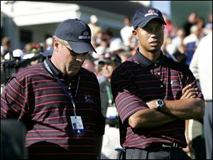 Captain Hal Sutton and top U.S. player Tiger Woods watch as the European team retains the Ryder Cup - by a commanding margin.