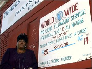 Fea  thomas20p  2140 Ashland Ave,  Thomas Temple Church of God in Christ.  Pastor  Susan Coleman outside the church.  Diane Hires  9/20/04