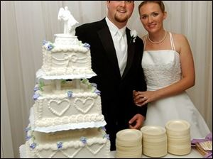 PIECE OF CAKE: Justin Ballard and Amanda Sheets find married life as delicious as Wixey cake.