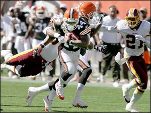 Lee Suggs, who made his first appearance of the season at running back for the Browns, breaks loose in the fourth quarter.