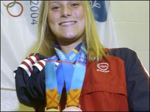 Beth Riggle shows off her medals - gold in the 400 medley relay, bronze in the 100 breaststroke - from the Paralympic Games.