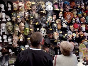 Customers survey the possibilities at Costume Holiday House on Monroe Street