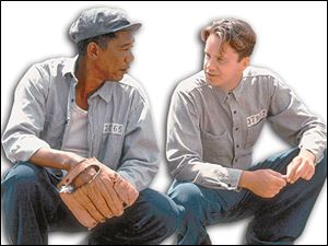 Morgan Freeman, left, and Tim Robbins in <i>The Shawshank Redemption</i>.