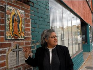 Maria L. Rodriguez-Winter shows off the painting of the Virgin of Guadalupe and the Ten Commandments on Broadway.