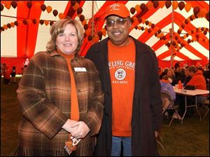 WELCOME HOME: Denise Olson, Class of '88, and Andre Craig, Class of '79, party with other BGSU grads.