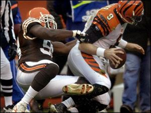 The Browns' Ebenezer Ekuban sacks Cincinnati quarterback Carson Palmer in the fourth quarter. The Bengals had just 58 yards rushing.