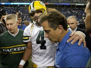 After moving up on the career lists in a couple categories, Green Bay's Brett Favre tried to comfort Lions coach Steve Mariucci.