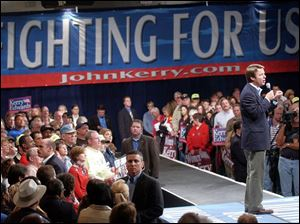 John Edwards campaigns in Canton, a hard-hit northeast Ohio industrial city. Mr. Edwards said a Kerry administration would reward industries that increase domestic employment.