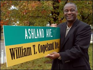 Cty Photo by Don Simmons Oct 20, 2004  Michael Ashford  Toledo City Councilman with the William T. Copeland street sign    ( copeland20p )