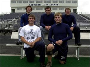 Some of the players whose fathers also were Wildcats are (back, from left) Elliot Vocke, Kyle Fruth and Brad Weaver, and (front, from left) Adam Miller and Keil Miller.