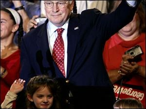 Vice President Dick Cheney, campaigning with granddaughters Elizabeth, left, and Kate, tells a Nazareth, Pa., crowd the United States remains focused on the war on terror.