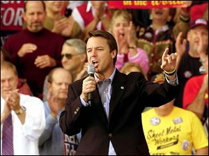 Vice presidential candidate John Edwards addresses a crowd of about 1,000 at the Ohio National Guard Armory in Marietta, Ohio. The Democrat talked mostly about domestic concerns.