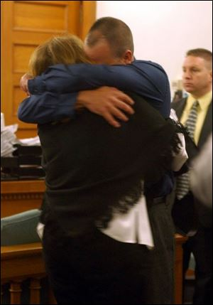 Richard Wisbon, the Libbey High School teacher acquitted of a sexual battery charge, hugs his wife, Lonnie, after the verdict was read in Lucas County Common Pleas Court.