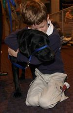 Canine-caregivers-offer-mobility-for-disabled-children