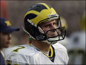 A glum Chad Henne was unable to become the first true freshman quarterback to lead his team to a win in this series.
