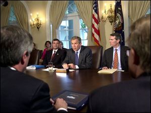 Cincinnati congressman Rob Portman seats to President Bush's left at a June 27, 2001, meeting in the Cabinet Room during a discussion on the Patient's Bill of Rights.