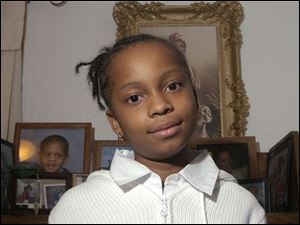 Aniqua Winters of Sherman Elementary School is thankful for family and friends in time of war.