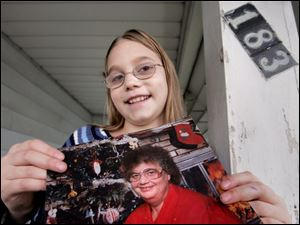 Jenna Pierson of Sherman Elementary School holds a photo of her grandmother. Jenna is thankful for firefighters who came to the rescue a few years ago when her grandmother had trouble bleeding.