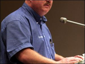 Toledo resident Ed Nagle speaks against a proposed trash fee during a meeting.