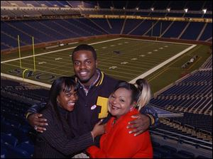When University of Toledo linebacker David Thomas plays in the Motor City Bowl in his hometown, aunts Felicia Fenderson, left, and Ann Fenderson will be watching over him - just as they always have.