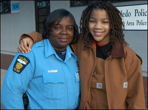 Through the STRIVE program, Toledo Police Officer Flo Wormely  has helped many young people graduate from high school.