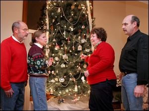 Roger Allmandinger, left, Kathy Kusisto-Allmandinger, and Anne and Bill Oldaker have spent past Christmases together.