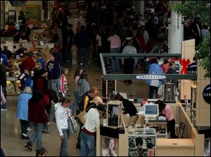 At Westfield Shoppingtown Franklin Park, shoppers flock to take advantage of day-after-Christmas sales.