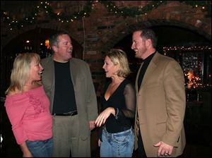 RARE OCCASION: From left, Lori and Ron Welty and Donna and Marty Gallagher gather at Mancy's Steak House for a rare but well-done get-together.