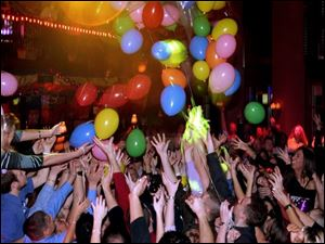 IN WITH NEW: Revelers try to catch balloons as 2005 dawns at Gumbo's Bayou Grille.