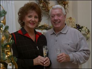 TOAST: Joyce and Bill Rimmelin host and toast the new year in their Sylvania home.