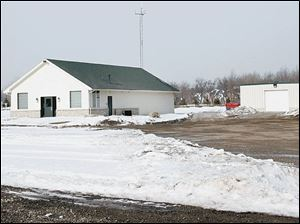 A former golf course clubhouse, left, and barn are being used as a meeting center and rescue-department garage by the township.