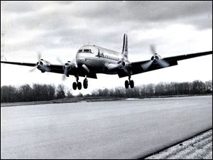 A Capital Airlines DC-4 is the first commercial plane to land at Toledo Express Airport on Jan. 6, 1955.