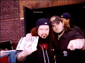 Josh Miller of Toledo, right, got a chance to meet his music idol, 'Dimebag' Darrell Abbott, left last year in Detroit.