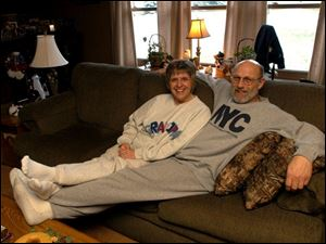 Cathi and Russ Bohland relax in their sweats on a Saturday afternoon. Mrs. Bohland is wearing the 'Grandpa' shirt she had given to her father.