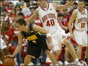 Matt Sylvester (40) and his Ohio State teammates held Iowa's Jeff Horner to nine points.