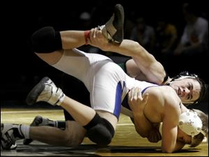 Delta's Jared Evans takes down Hilliard Davidson's Jimmy Millar in the 103-pound championship match at the Perrysburg Invitational. Evans won with a pin in the first period.