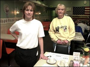 Waitress Lisa Rhodes, left, and assistant manager Barbara Jacquot work at White Lattice Cafe, where police ordered removal of ashtrays Friday after they found smoking in the building.
