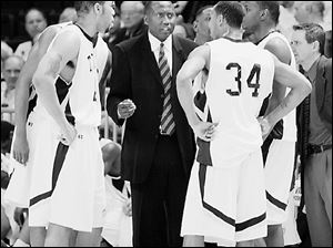 UT coach Stan Joplin talks with his team during last night's game.