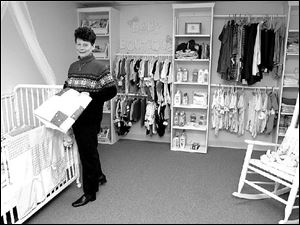 Sheri Phillips, publicity director, organizes items in the Pregnancy Center of Greater Toledo's 'Baby Boutique.'