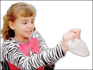Brooke Beamer, 9, pops