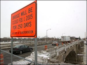 A sign alerts motorists to the impending bridge closure in Napoleon. The 75-year-old span will be demolished and rebuilt.