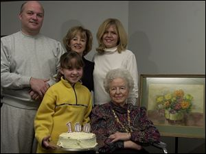 Grandson Stephen Slayton, top row, daughter Susan Cowling, granddaughter-in-law Elaine Slayton, and great-great granddaughter Emma Slayton, helped Marian Childs celebrate her birthday.