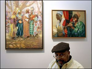 Artist Wil Clay with two of his paintings, Cameroon Market,