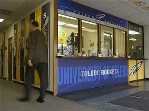 Outside the University of Toledo's Savage Hall ticket office are new graphic panels, some displaying former and current Rocket athletes.