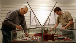 David Bush, left, professor of anthropology at Heidelberg College, and student Andy VanCamp assemble artifacts at the Rutherford B. Hayes Presidential Center, Fremont, Ohio, from excavations on the island.