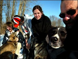Delta sled-dog racers, from left, Anthony Griffith, Jamie Collier, family friend Stephanie Miler, and Mike Collier, the boy
